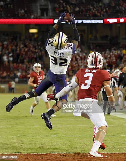 Budda Baker of the Washington Huskies intercepts a pass intended for Michael Rector of the Stanford Cardinal's in the fourth quarter of an NCAA...