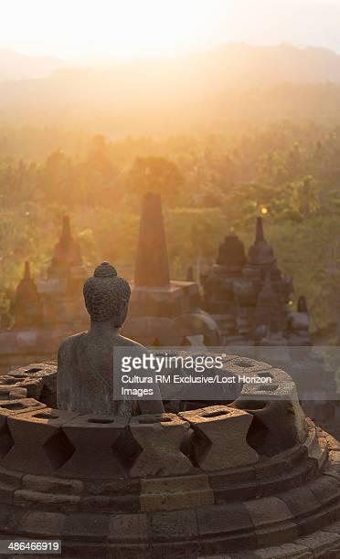 Buddha and morning mist, The Buddhist Temple of Borobudur, Java, Indonesia