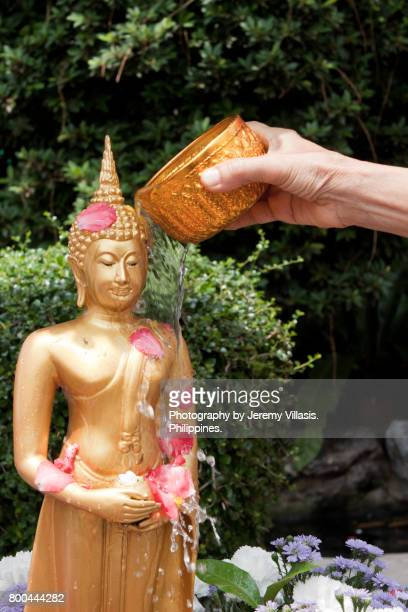 Buddha Bathing Ceremony during Songkran in Wat Pho, Bangkok, Thailand