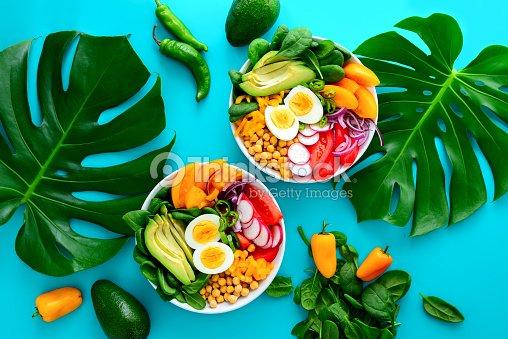 Buddha bowl salad served on monstera leaves : Stock Photo