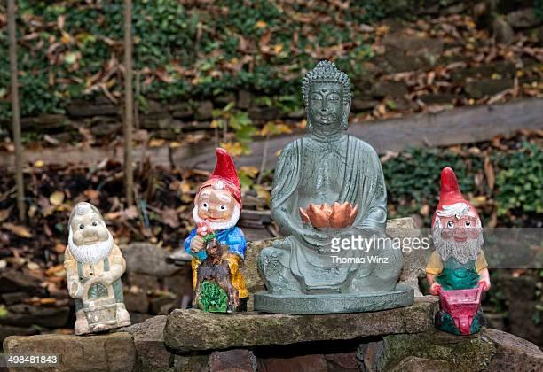 Buddha figure and garden gnomes
