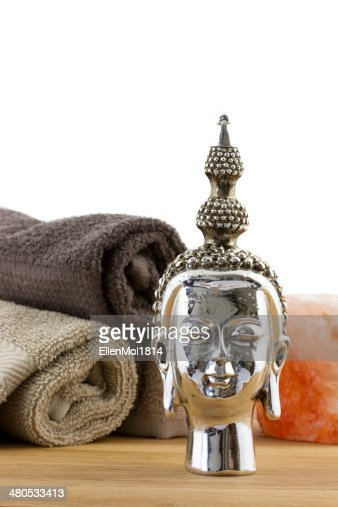 buddha figure with towels on the background : Stockfoto