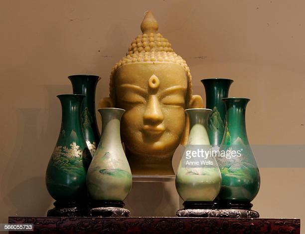 JUNE 4 2008 – Buddha head candle surrounded by four porcelain vases owned by Tony Duquette in the bedroom of interior designer Susan Cohen's Santa...