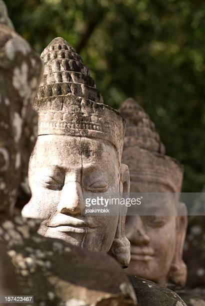 Buddha head sculpture in a row