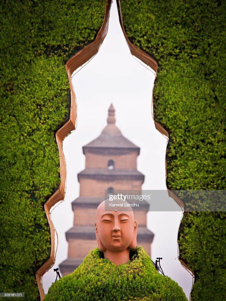 Buddha in front with White Goose Pagoda