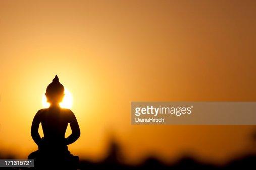 buddha silhouette and real sunrise