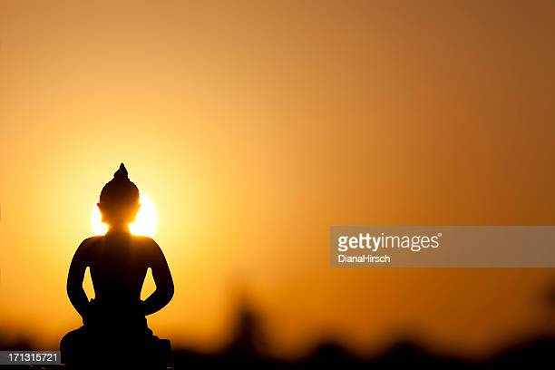 buddha silhouette and real sunrise