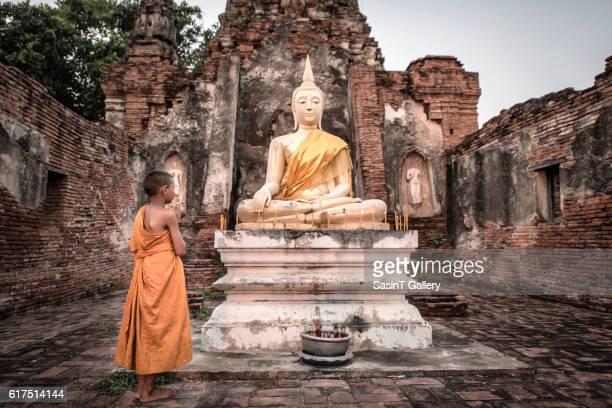 Buddha statue and Novice in Ayutthaya