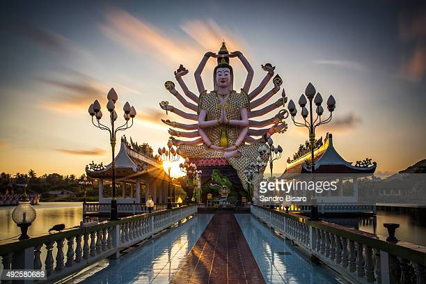 Buddha statue at Wat Plai Laem at sunrise.