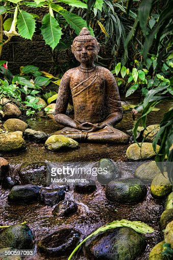 Buddha Statue In Garden Stock Photo Getty Images