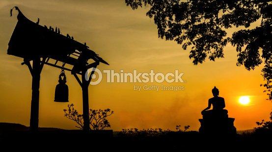 Buddha statue in sunset : Stock Photo