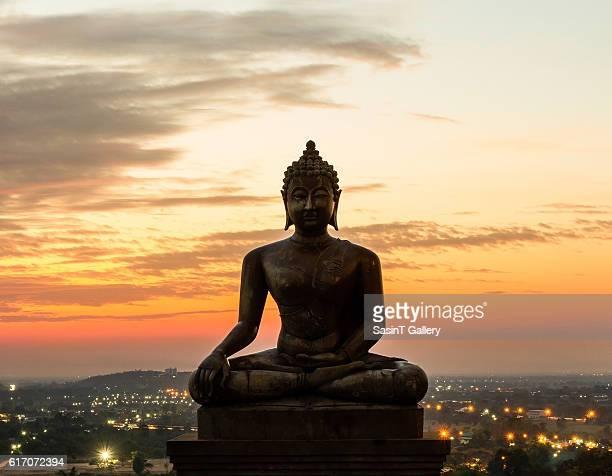 Buddha statue in sunset