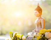 Buddha statue in thailand with sunlight on morning