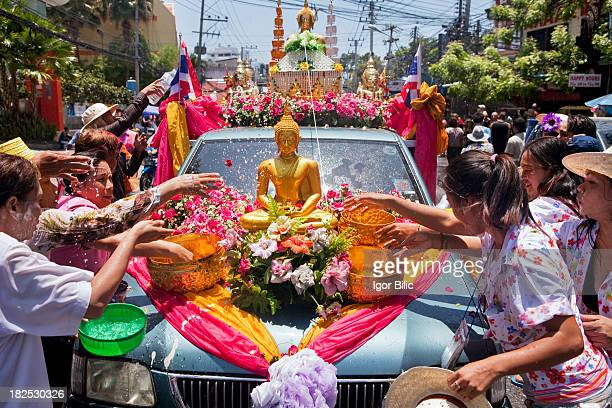 Buddha statue is cleaned with water by Thai women an annual ritual for the holiday of Songkran or Thai New Year Pattaya Thailand The most obvious...