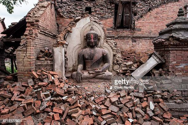 Buddha statue sits among the debris of a collapsed temple on April 29 2015 in Bhaktapur Nepal A major 78 earthquake hit Kathmandu midday on Saturday...