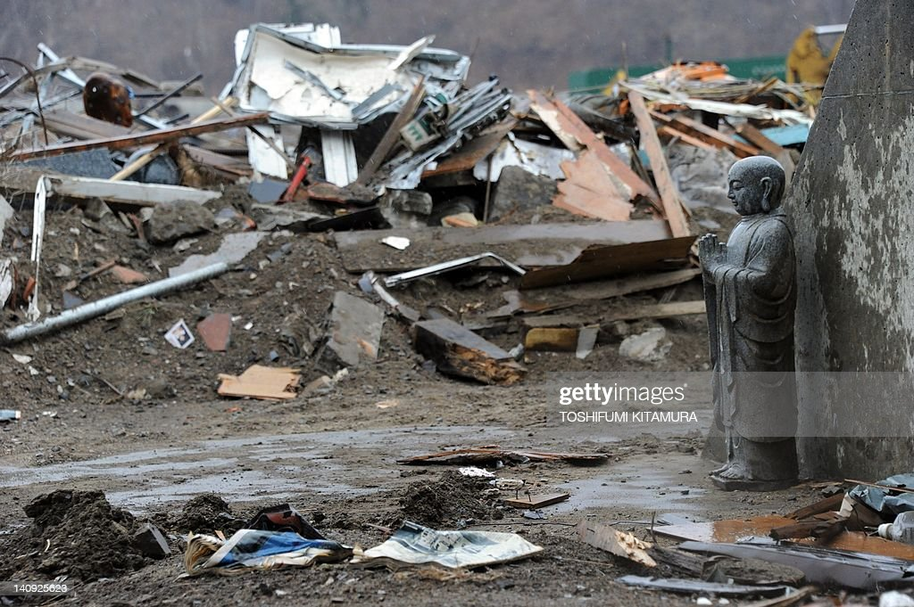 A buddha statue stands beside the breakwater wall in the Taro area of Miyako, Iwate prefecture on April 19, 2011. The Japanese government urged local authorities, businesses and citizens not to discriminate against evacuees from the area around the crippled Fukushima nuclear plant.
