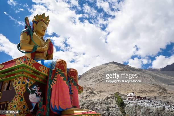 Buddha statue with Himalaya mountain at Diskit Monastery Nubra valley