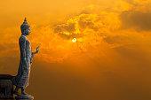 Big Buddha statue on sunset sky