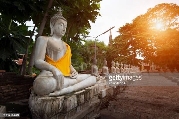 Buddha Temple and monk in Ayuthaya Historical Park, a UNESCO world heritage site in Thailand.
