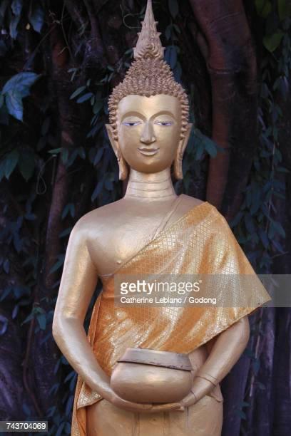 Buddha Wednesday. Alm bowl. Wat Inpeng. Vientiane. Laos.  Laos.