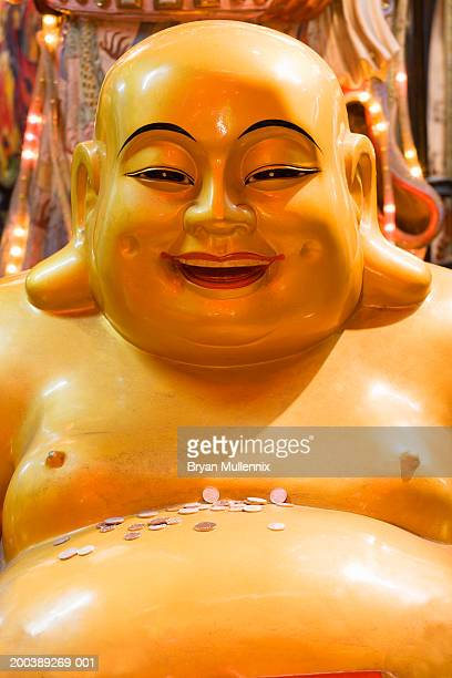 Buddha with money on stomach