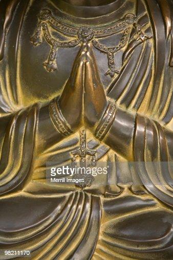 Buddha's hands clasped in prayer
