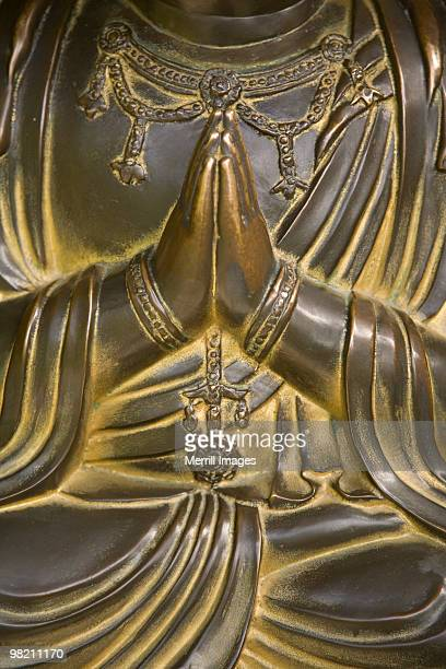 Buddha's hands clasped in prayer