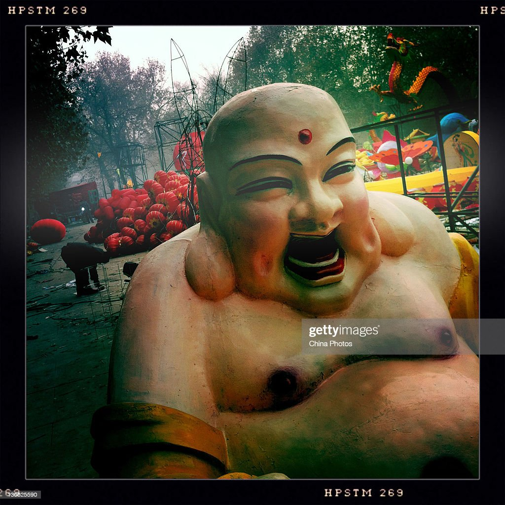 A Buddhashaped lighting decoration prepared for the upcoming Spring Festival is seen at the Small Wild Goose Pagoda Park on January 9 2012 in Xian of...