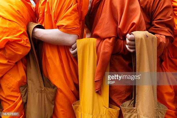 Buddhism Monks lining to receive alms on Meak Bochea Makha Bucha holiday