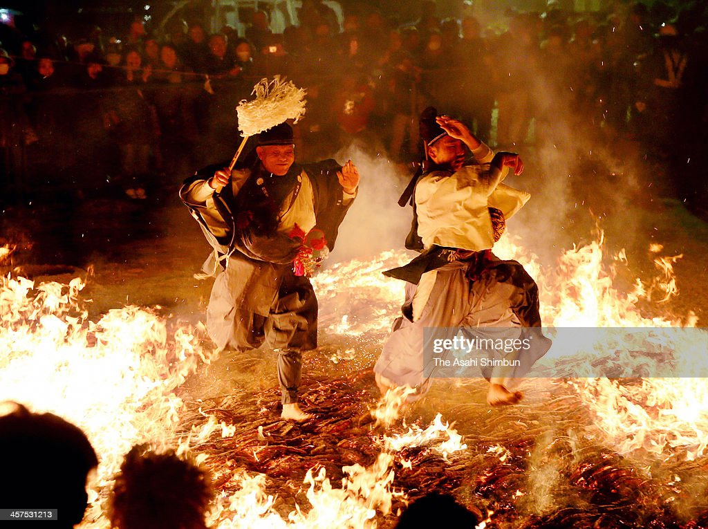 Buddhism practitioners walk berefoot on the fire during the 'Hiwatari (walking on fire)' ritual at Akihasan Entsuji Temple on December 16, 2013 in Nagoya, Aichi, Japan. The annual ritual is thought to remove bad luck and pray for good health.