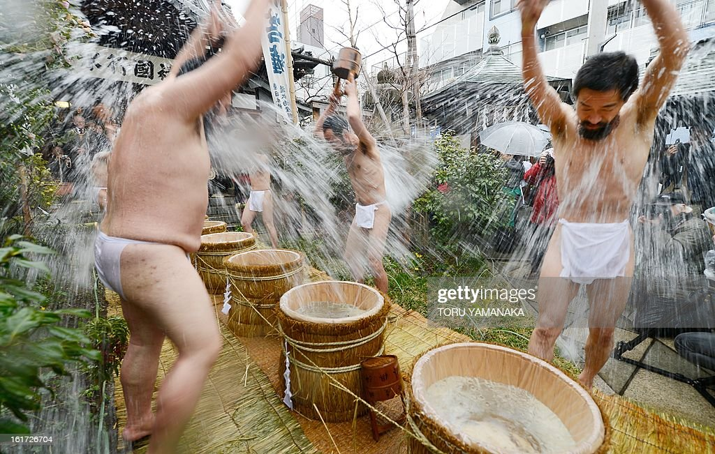 Buddhist ascetics splash cold water ove their body at the end of their 100-day austere Bhuddhism training to pray for peace in the world at Nose Myokenzan Betsuin temple in Tokyo on February 15, 2013 on the anniversary of Buddha's death. AFP PHOTO/Toru YAMANAKA