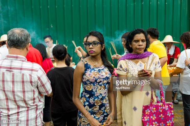 Buddhist devotees pictured during Vesak day celebration in Kuala Lumpur Malaysia on May 10 2017 Vesak day on the fullmoon day of the sixth lunar...