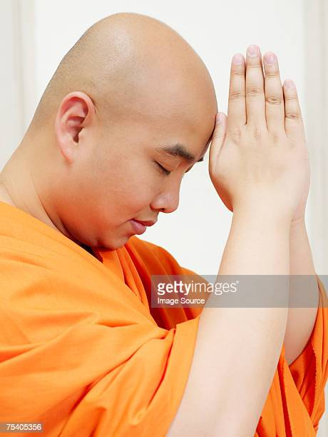 Buddhist man praying