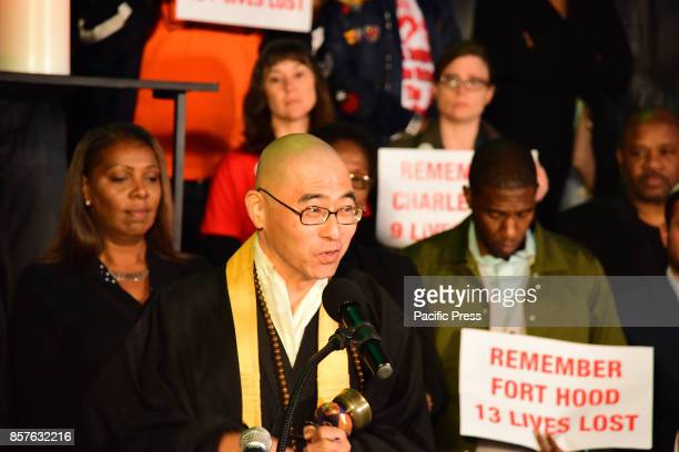 Buddhist minister invokes prayer with bell ringing during Brooklyn Borough President Eric Adams brought political and religious leaders together onto...