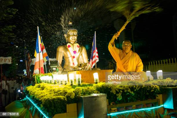 Buddhist monk and devotees take part in parade during Vesak day celebration in Kuala Lumpur Malaysia on May 10 2017 Vesak day on the fullmoon day of...