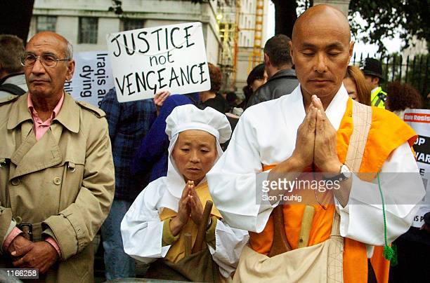 Buddhist monk and nun chant October 2 2001 during a vigil for peace opposite the British Prime Minister's residence in Downing Street in London