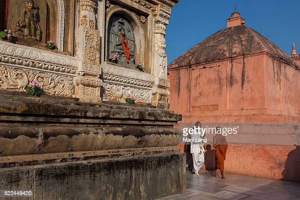 BODHGAYA BIHAR INDIA BODHGAYA BIHAR INDIA Buddhist monk and pilgrim walking in the Mahabodhi temple complex Bodhgaya Bihar India The Mahabodhi Temple...