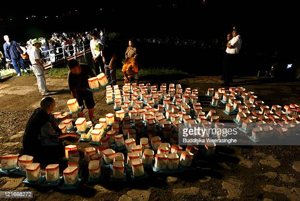 Buddhist Monk arranges lanterns during celebrations for the Obon Festival honouring the spirits of deceased ancestors at Eiheiji on August 21 2011 in...