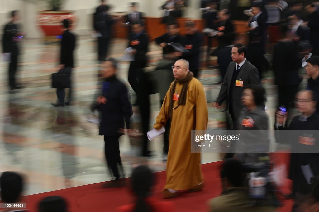 A Buddhist monk delegate arrives at the Great Hall of the People to attend a plenary session of the National People's Congress on March 10, 2013 in Beijing, China. The State Council, China's cabinet, will begin its seventh restructuring attempt in the past three decades to roll back red tape and reduce administrative intervention. Several departments under the State Council will be reorganized according to a plan on the institutional restructuring and functional transformation of the State Council, which was submitted to the plenary session of the National People's Congress Sunday.