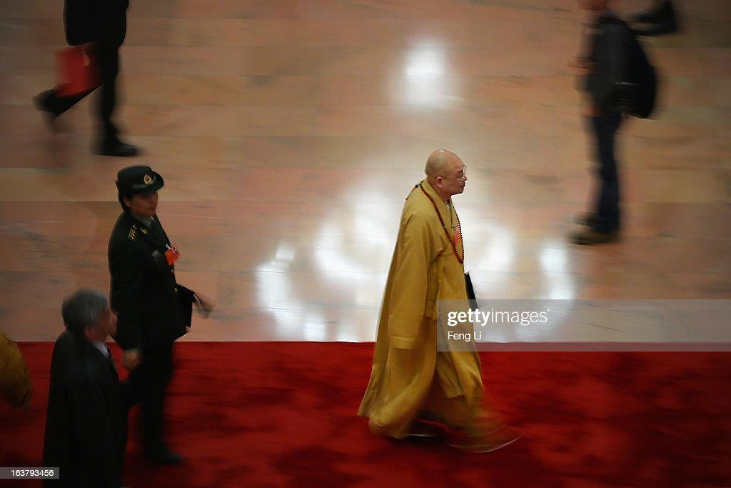 A Buddhist monk delegate leaves after the sixth plenary meeting of the National People's Congress at the Great Hall of the People on March 16, 2013 in Beijing, China. The new lineup of China's State Council, nominated by Premier Li Keqiang, was endorsed by lawmakers at the ongoing national legislative session Saturday afternoon.