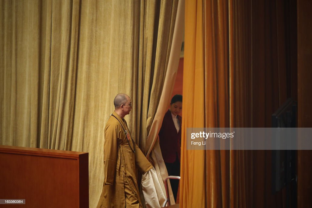 A Buddhist monk delegate walks out the meeting room of the Great Hall of the People during a plenary session of the Chinese People's Political Consultative Conference on March 8, 2013 in Beijing, China. Clearing urban air pollution has become a big concern during the National People's Congress.