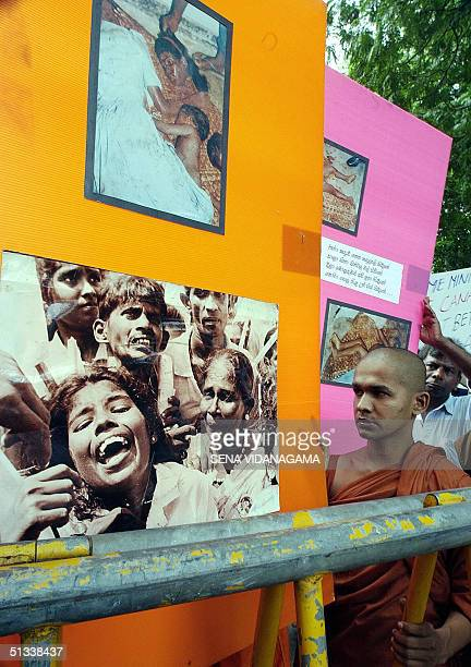 Buddhist monk hold posters urging Canada not to allow Tamil rebels to stage a cultural show known as Pongu Thamil in that country during a...