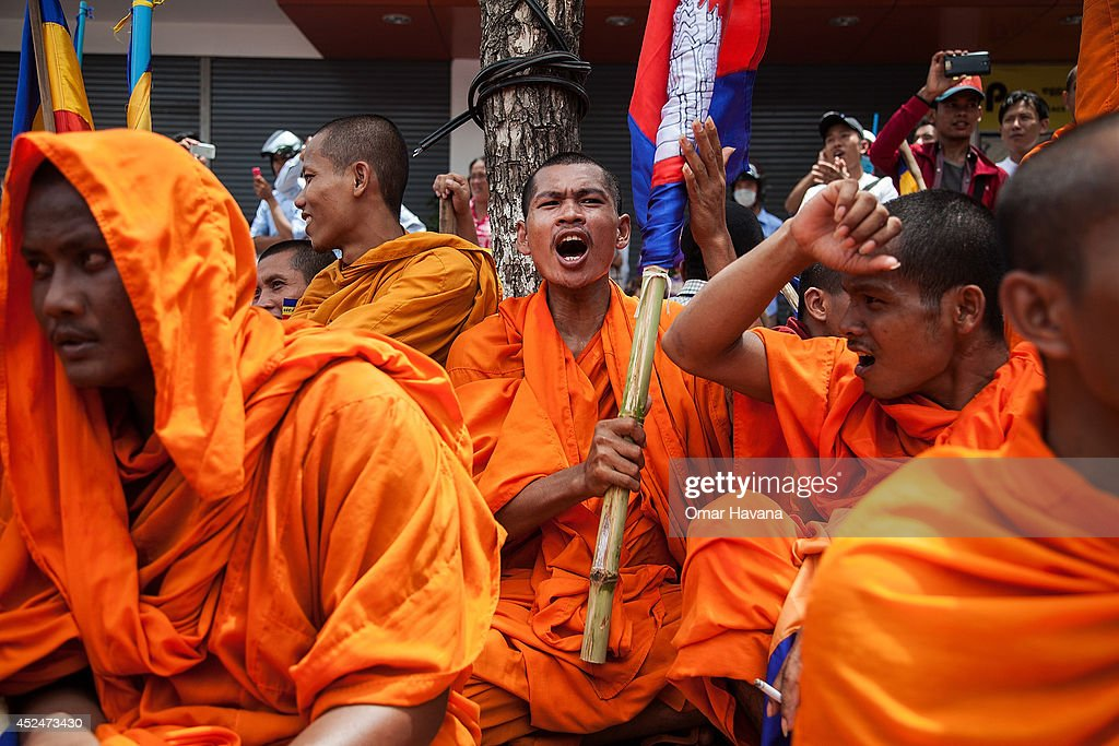 A Buddhist monk holding a Cambodian National Flag shouts slogans while listening to speeches during a demonstration to deliver petitions to different embassies on July 21, 2014 in Phnom Penh, Cambodia. Thousands of protesters and monks march through the streets of Phnom Penh to deliver petitions to the French, British, American, Russian and Chinese embassies, before arriving at the Vietnamese Embassy. The protesters, organised by the Federation of Cambodian Intellectuals and Students (FCIS) and leaders of the Khmer Krom community, are demanding an apology from Vietnamese Embassy First Counsellor Tran Van Thong, who recently said that the former Kampuchea Krom provinces were held by Vietnam before their occupation by France. Ahead of the protest, Phnom Penh municipal authorities banned the protest, threatening the protesters who defied the ban could be jailed for up to 15 years.