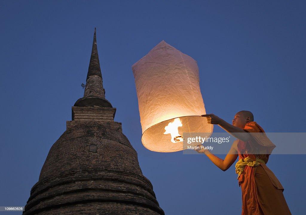 Buddhist Monk holding Khom Loy Lantern : Stock Photo