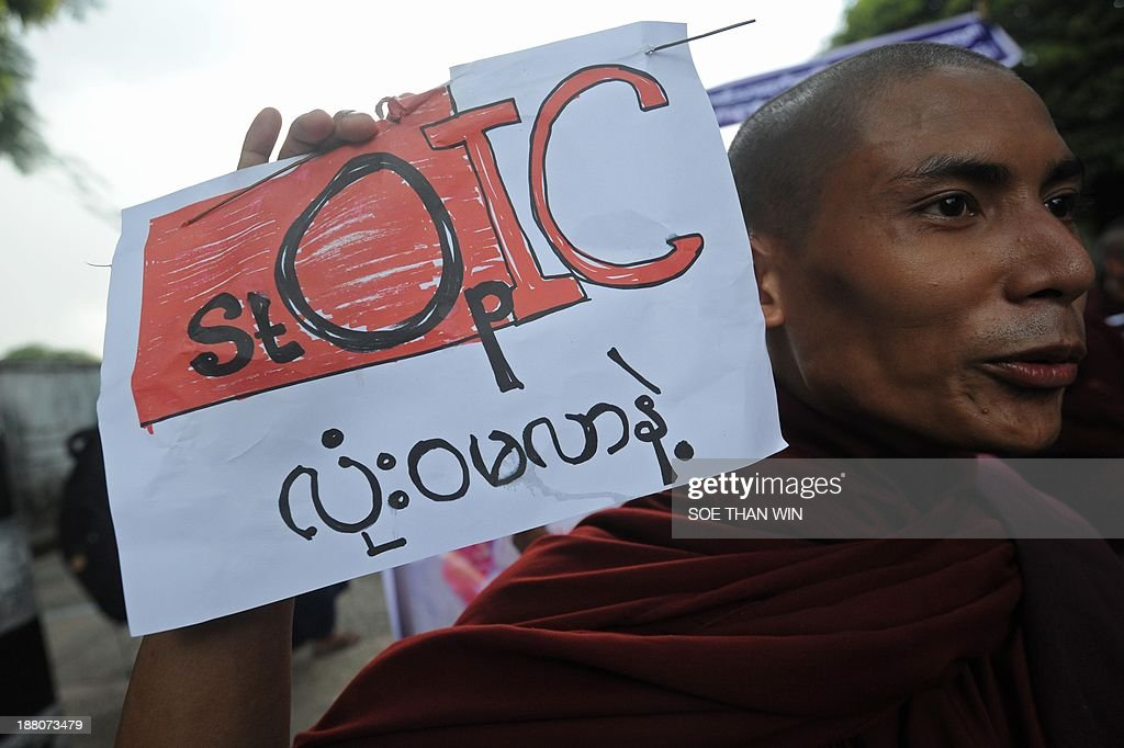 A Buddhist monk holds a sign during a demonstration against a visit by members of the Organisation of Islamic Cooperation (OIC), in Yangon on November 15, 2013. Myanmar Buddhist monks led rallies against the Organisation of Islamic Cooperation as delegates from the Muslim body toured western Rakhine state, where religious violence has torn communities asunder. The delegation from the world's top Islamic body is in the country to discuss the response to several bouts of anti-Muslim violence that have left some 250 people dead and tens of thousands homeless. AFP PHOTO/ SOE THAN WIN
