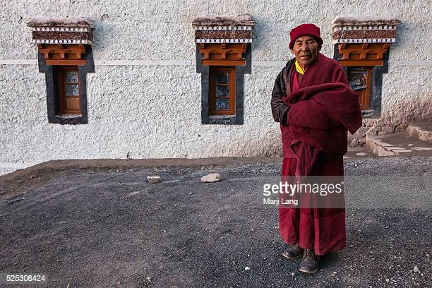 Buddhist monk in front of Hemis gompa in Ladakh Jammu and Kashmir India