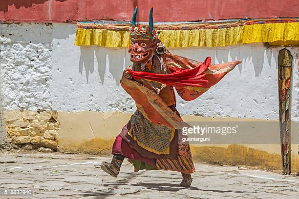 Buddhist monk is performing a sacred dance in Ladakh.