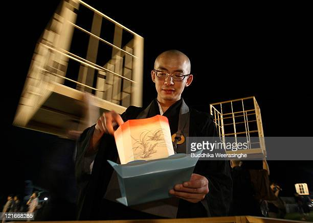 Buddhist Monk lights a lantern during celebrations for the Obon Festival honouring the spirits of deceased ancestors at Eiheiji on August 21 2011 in...