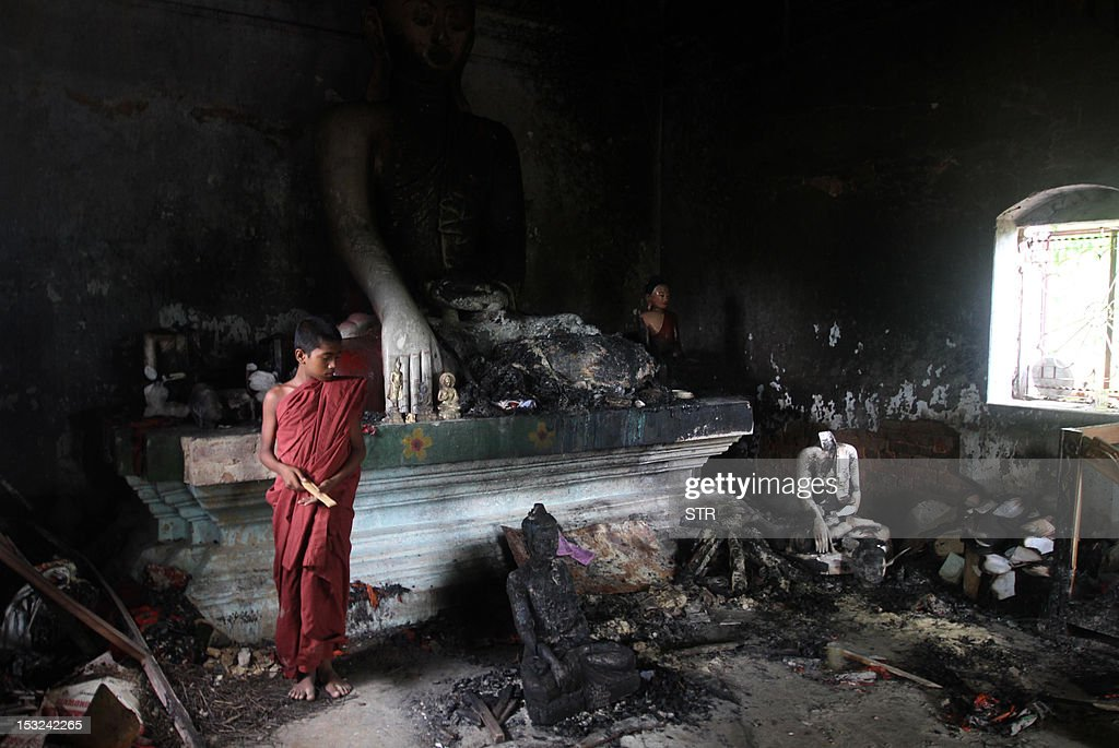 A Buddhist monk looks on in a burnt temple in Cox's Bazar, some 396 kilometres (246 miles) from the capital Dhaka on October 2, 2012. Bangladesh police said they had arrested nearly 300 people after Muslim mobs attacked temples and houses in what Buddhist leaders described as the worst violence against the community since independence.