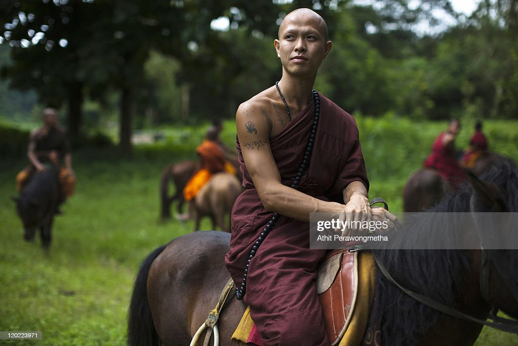 A Buddhist monk looks toward at The Golden Horse Monastery (Wat Tam Pa Ar-Cha Thong) on August 1, 2011 in Chiang Rai, Thailand. The monastery, founded by former Thai boxing champion Phra Kru Ba Neua Chai who became a Buddhist monk , takes in destitute children, training them in equestrian skills on horses, many of which have been saved from slaughterhouses, and Thai boxing. .
